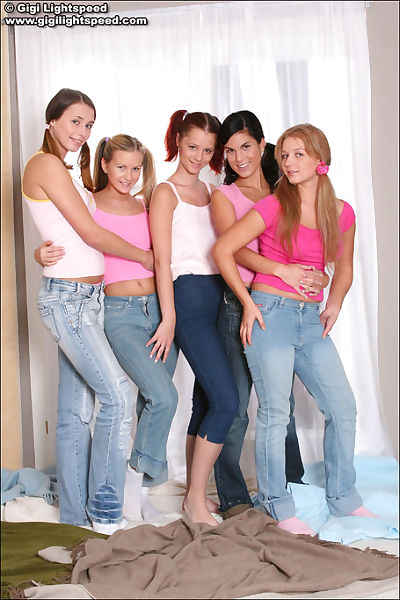 Group of lewd youthful dykes posing simultaneously