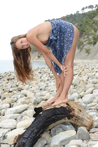 Ideal young angel Geissa slides her clothing of to instance uncovered on rocky shoreline