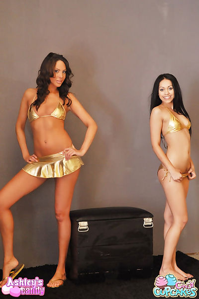 Dual chicks in shiny gold bikinis strip off and mole their appealing infant mangos and anuses