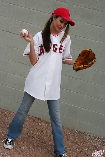 Sporty young darling looking clammy in baseball field